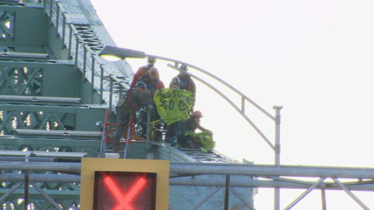 Climate activists with the Quebec chapter of Extinction Rebellion scaled the structure of Montreal's Jacques Cartier Bridge Tuesday.