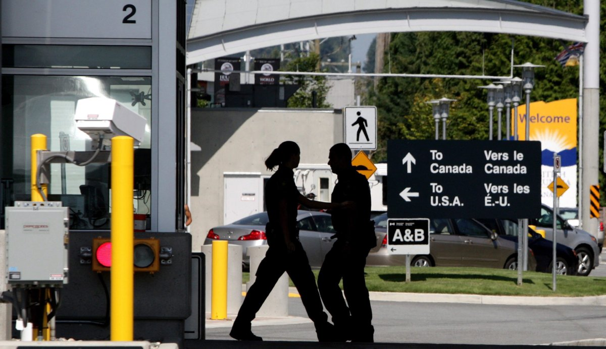 Canadian border guards are silhouetted as they replace each other at an inspection booth at the Douglas border crossing on the Canada-USA border in Surrey, B.C., on Thursday August 20, 2009. One year after pot became legal in Canada, it's still a tricky issue to cross the U.S. border where marijuana is not legal federally.
