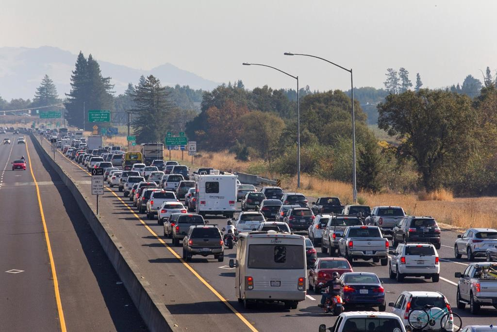 Traffic is backed up heading South on Highway 101 during mandatory evacuations due to predicted danger from the Kincade Fire, in Windsor, Calif., on Saturday, Oct. 26, 2019. The entire communities of Healdsburg and Windsor were ordered to evacuate ahead of strong winds that could lead to erratic fire behavior near the blaze burning in wine country. (Darryl Bush/The Press Democrat via AP).