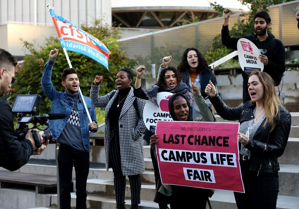"Students protest outside court before a hearing in Toronto on Friday, Oct. 11, 2019. The students are challenging the Ontario government's ""student choice initiative,"" which makes certain supplementary fees optional."