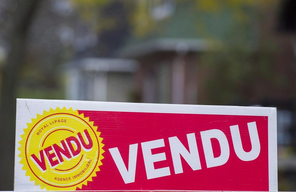 A sign meaning sold is shown on the west island of Montreal on November 4, 2017.