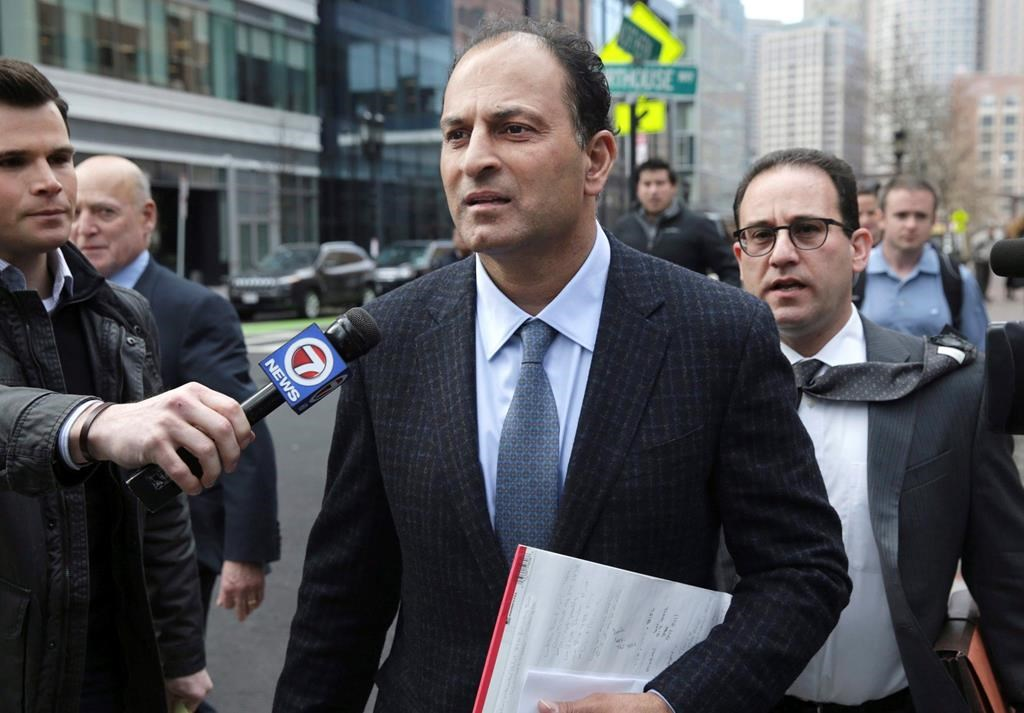 A well-known businessman and philanthropist from British Columbia faces fresh allegations in a new indictment filed in a college bribery scandal unfolding in the United States. David Sidoo, of Vancouver, leaves following his federal court hearing in Boston, Friday, March 15, 2019.