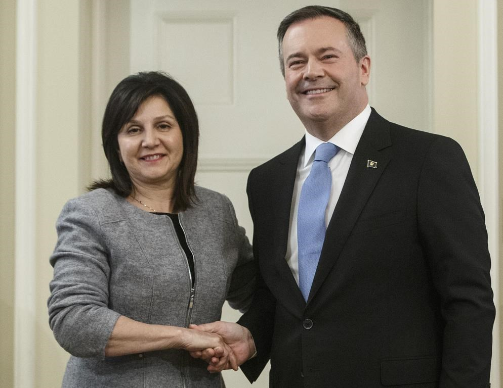 Alberta premier Jason Kenney shakes hands with Adriana LaGrange, Minister of Education after being is sworn into office, in Edmonton on Tuesday April 30, 2019.
