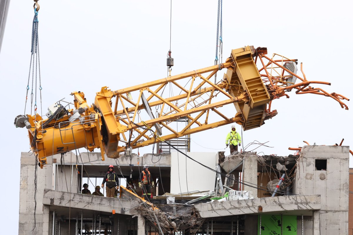 The final piece of a collapsed construction crane is removed by a construction crew on Oct. 26, 2019.