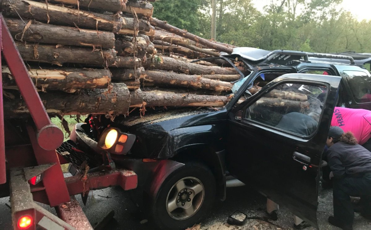 A car crashed into the back of a logging truck on Oct. 11.