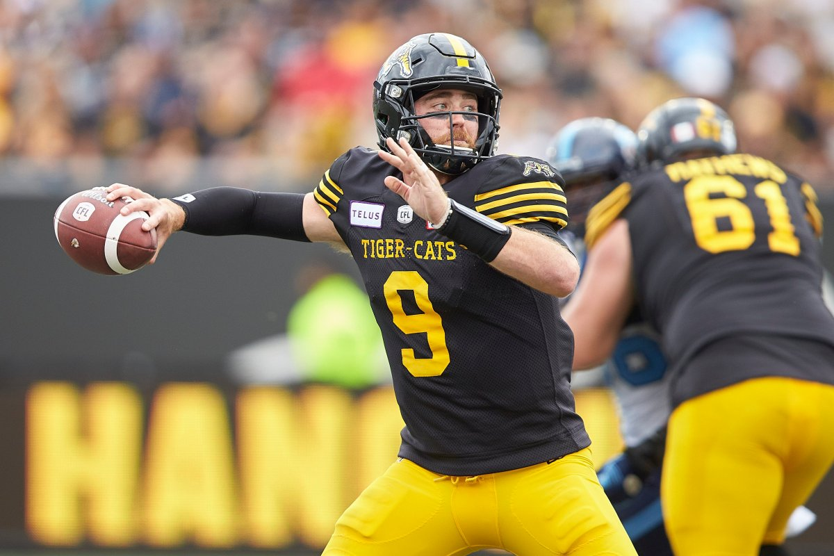 Tiger-Cats Quarterback Dane Evans throws a pass in 2019 CFL game at Tim Horton's field in Hamilton, Ont.
