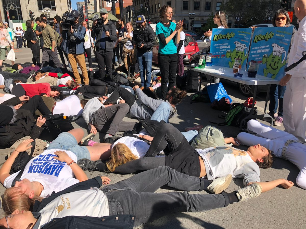 Climate activist group Extinction Rebellion perform a die-in protest in downtown Montreal on Sunday, Oct. 13, 2019.
