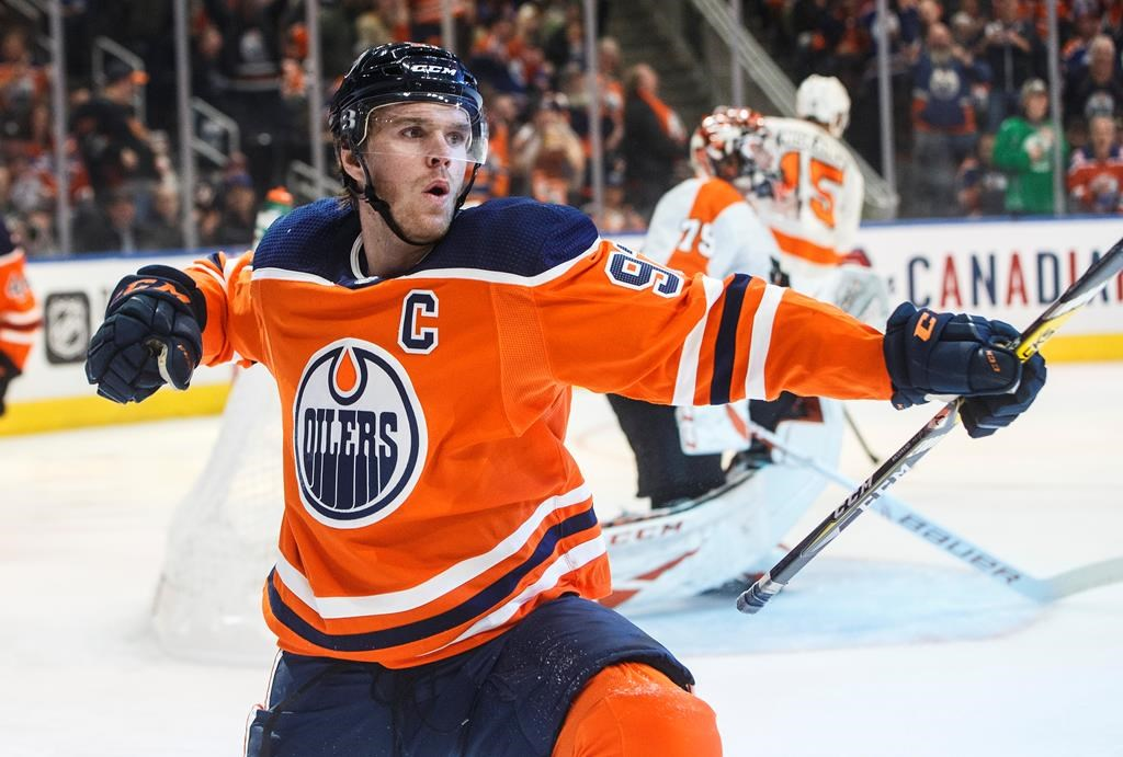 Edmonton Oilers' Connor McDavid (97) celebrates a goal against the Philadelphia Flyers during second period NHL action in Edmonton, Alta., on Wednesday October 16, 2019. THE CANADIAN PRESS/Jason Franson.