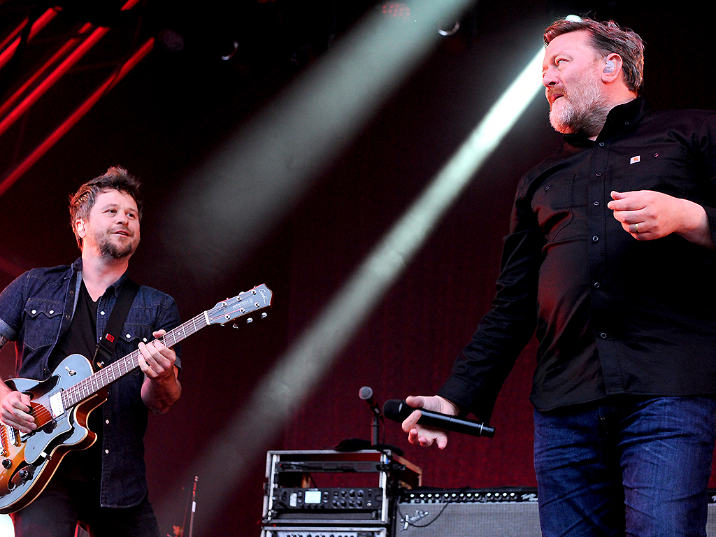 Guy Garvey and Mark Potter of Elbow perform at Castlefield Bowl on July 9, 2019 in Manchester, England.