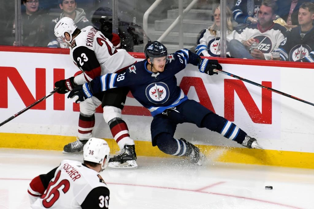 Winnipeg Jets' Jack Roslovic (28) and Arizona Coyotes' Oliver Ekman-Larsson (23) collide during third period NHL action in Winnipeg on Tuesday, Oct. 15, 2019. THE CANADIAN PRESS/Fred Greenslade.