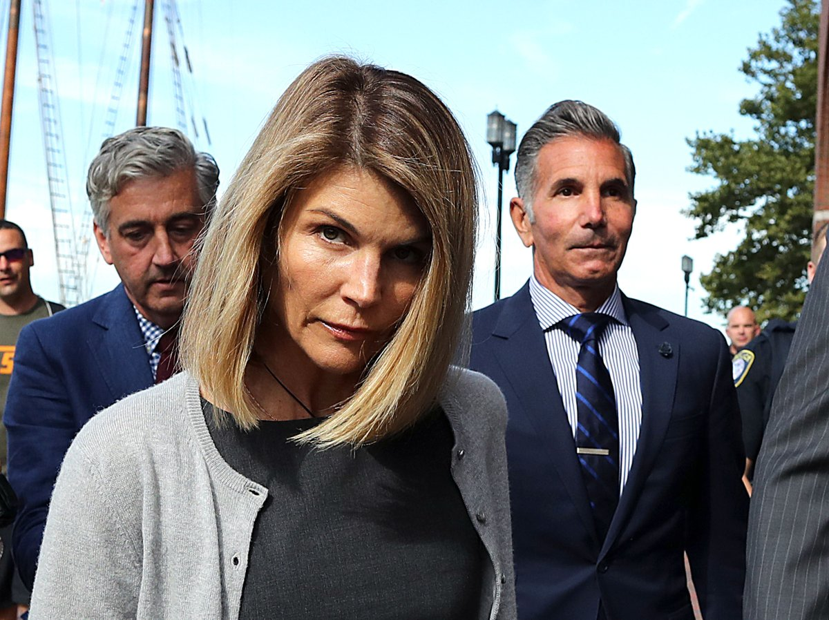Lori Loughlin and her husband Mossimo Giannulli, right, leave the John Joseph Moakley United States Courthouse in Boston on Aug. 27, 2019.