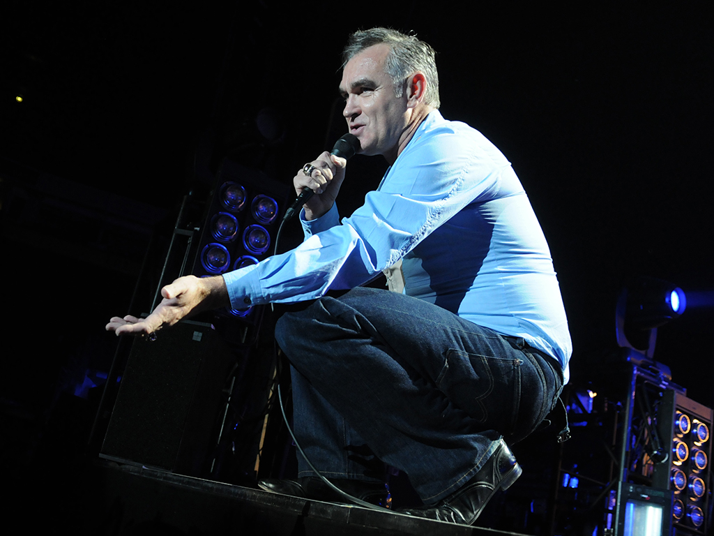 Morrissey performs on stage at Manchester Arena on July 28, 2012 in Manchester, United Kingdom.