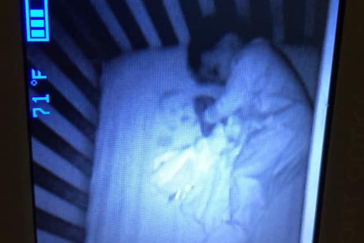 Maritza Cibuls' son, Lincoln, is shown beside a ghostly baby face that appeared in his crib.