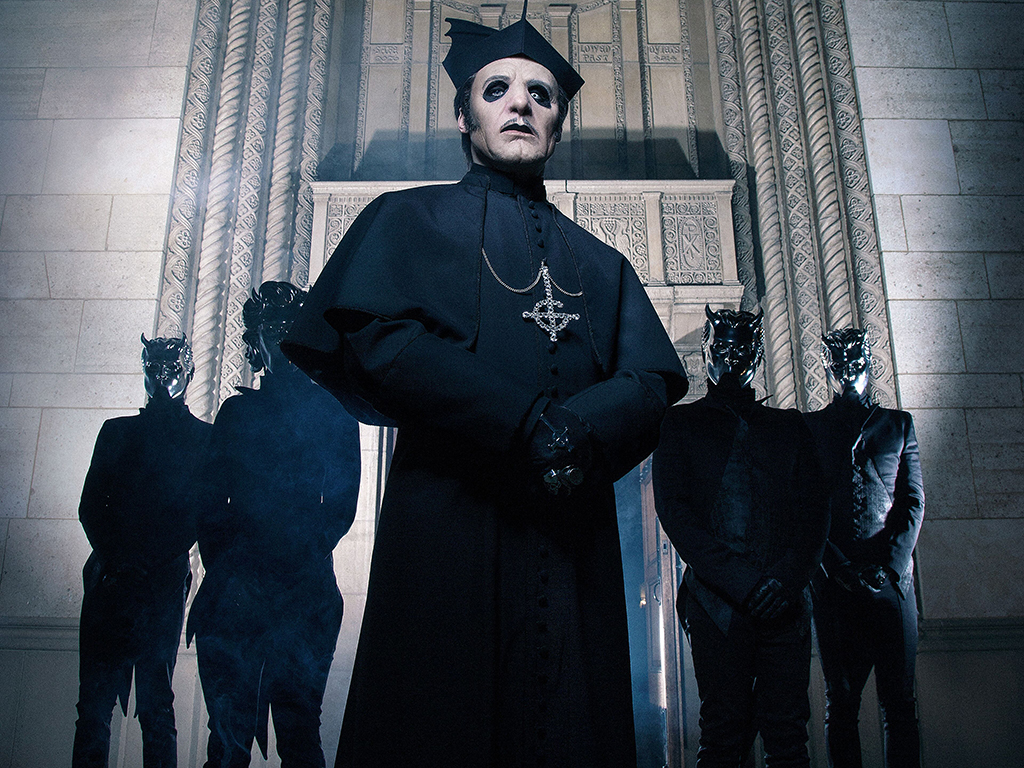 """Ghost: Tobias Forge as Cardinal Copia (C) with his backing band, the """"Nameless Ghouls,"""" in 2019."""