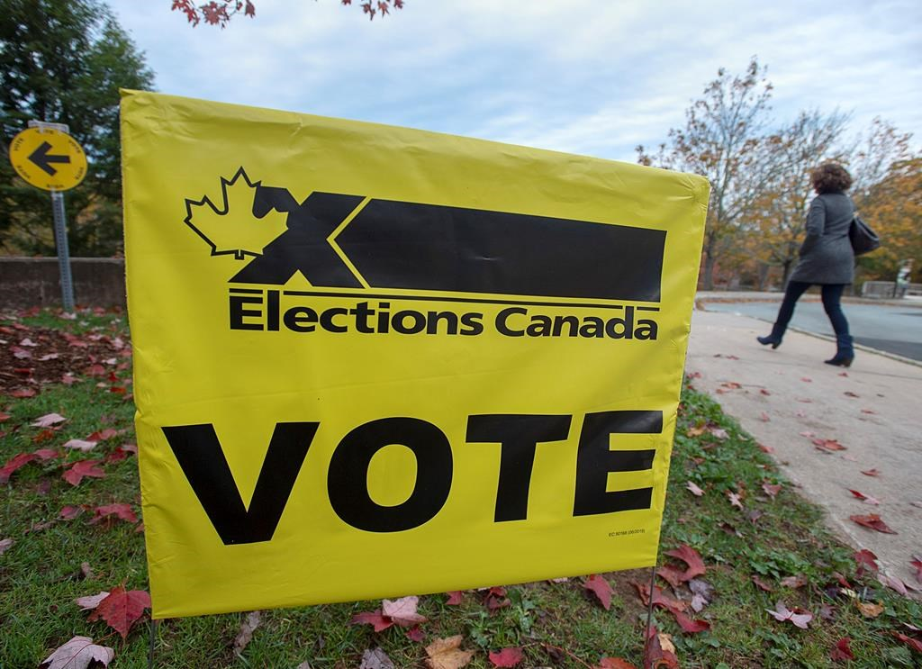 A voter heads to cast their vote in Canada's federal election at the Fairbanks Interpretation Centre in Dartmouth, N.S., Monday, Oct. 21, 2019.