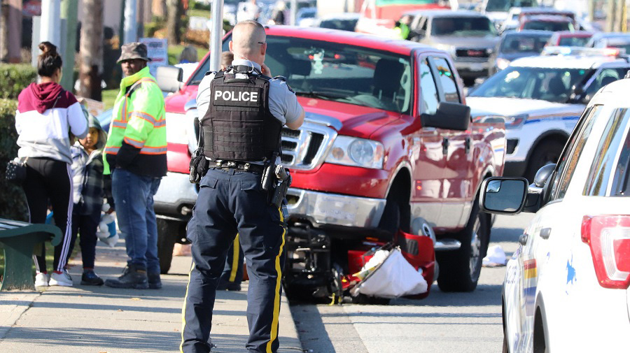 Surrey RCMP at the scene of a collision involving a pickup truck and a mobility scooter on Oct. 26, 2019.