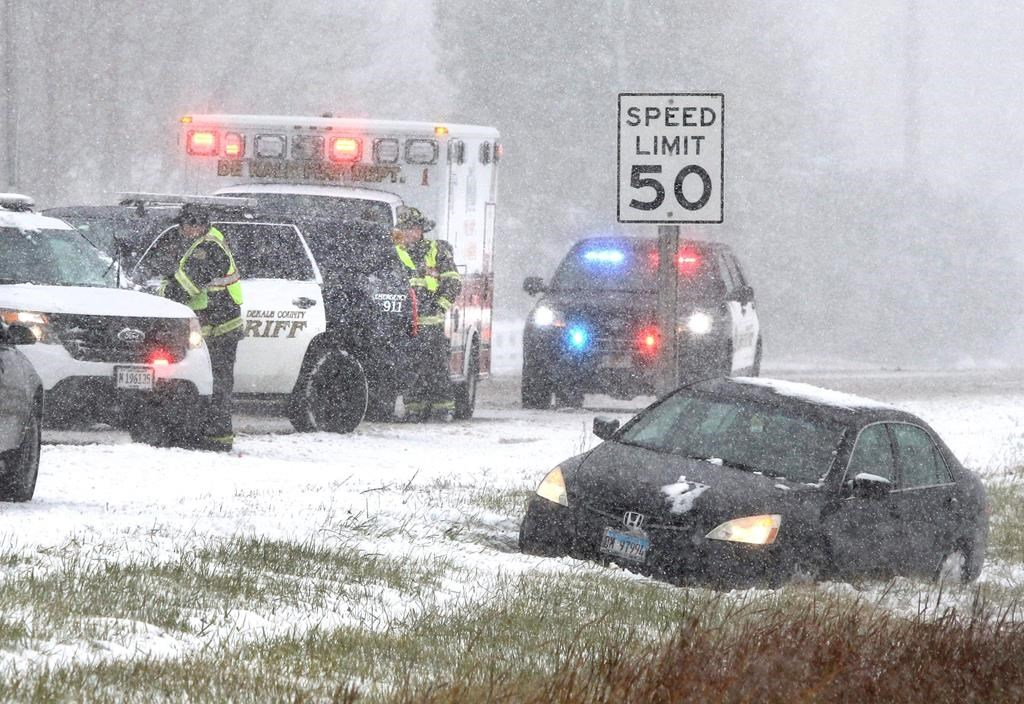 DeKalb County Sheriff's deputies and DeKalb firefighters and paramedics respond to a car in the ditch on Route 23 just south of Gurler Road as snow and wind continue to make driving hazardous in DeKalb Thursday, Oct. 31, 2019. A Halloween snow storm blanketed much of the area with ice and snow Wednesday night into Thursday. (Mark Busch/Daily Chronicle via AP).
