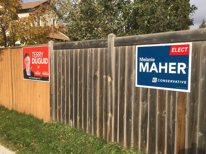 Campaign signs for the Liberal's Terry Duguid and the Conservative's Melanie Maher in the Winnipeg South riding.