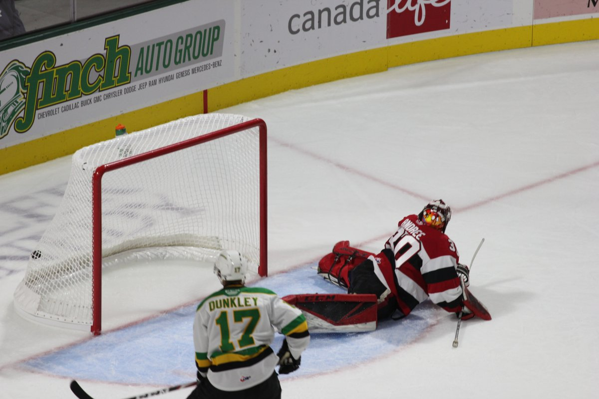 London, Ont. - Nathan Dunkley of the London Knights watches as a Connor McMichael shot finds the back of the net behind Ottawa 67's goalie Cedrick Andree in a 3-0 Knights win at Budweiser Gardens on October 4, 2019.