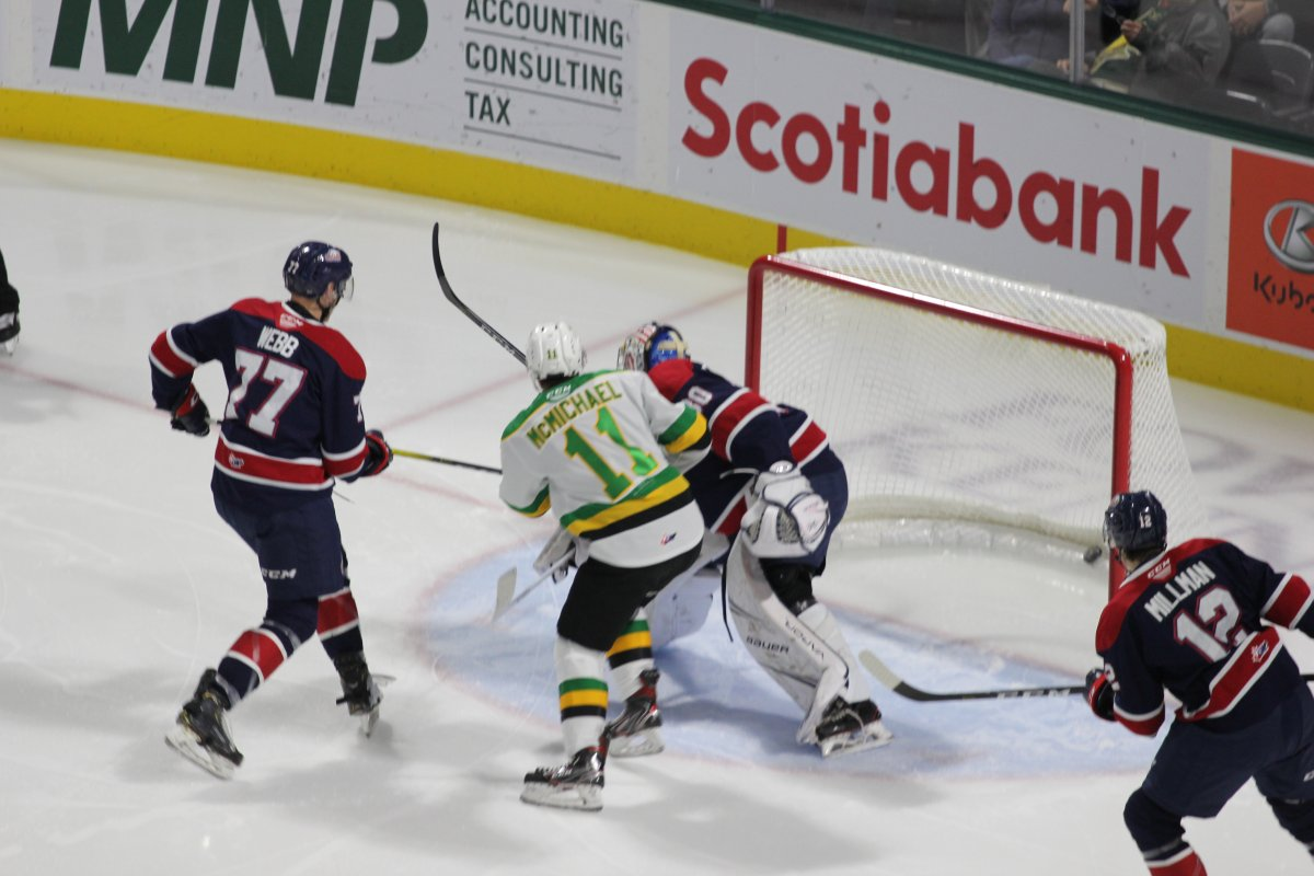 Connor McMichael of the London Knights knocks the puck past Saginaw Spirit goalie Tristan Lennox as the Knights defeated the Spirit 5-1 on Oct. 25, 2019, at Budweiser Gardens.