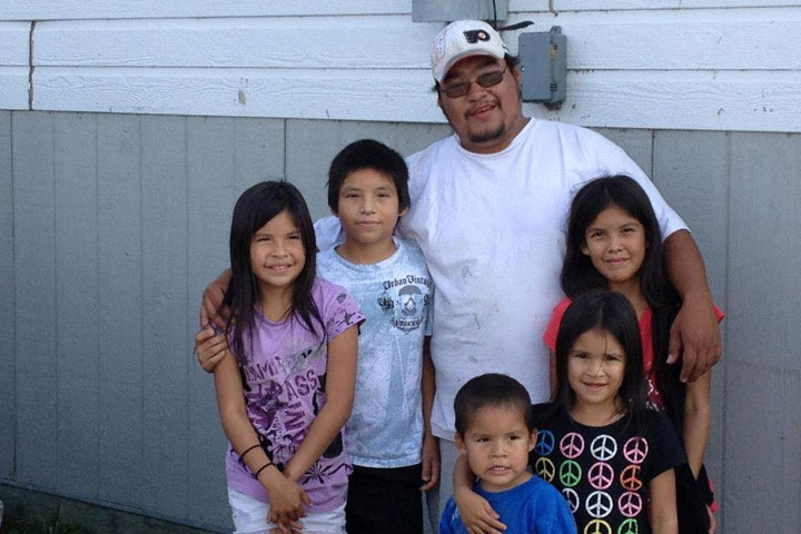 Tyson McKay, of the northern Manitoba indigenous community of Cross Lake, poses with his nieces and nephews in the fall of 2014. McKay died from a heart attack in 2015, shortly after visiting the remote reserve's federal government clinic.