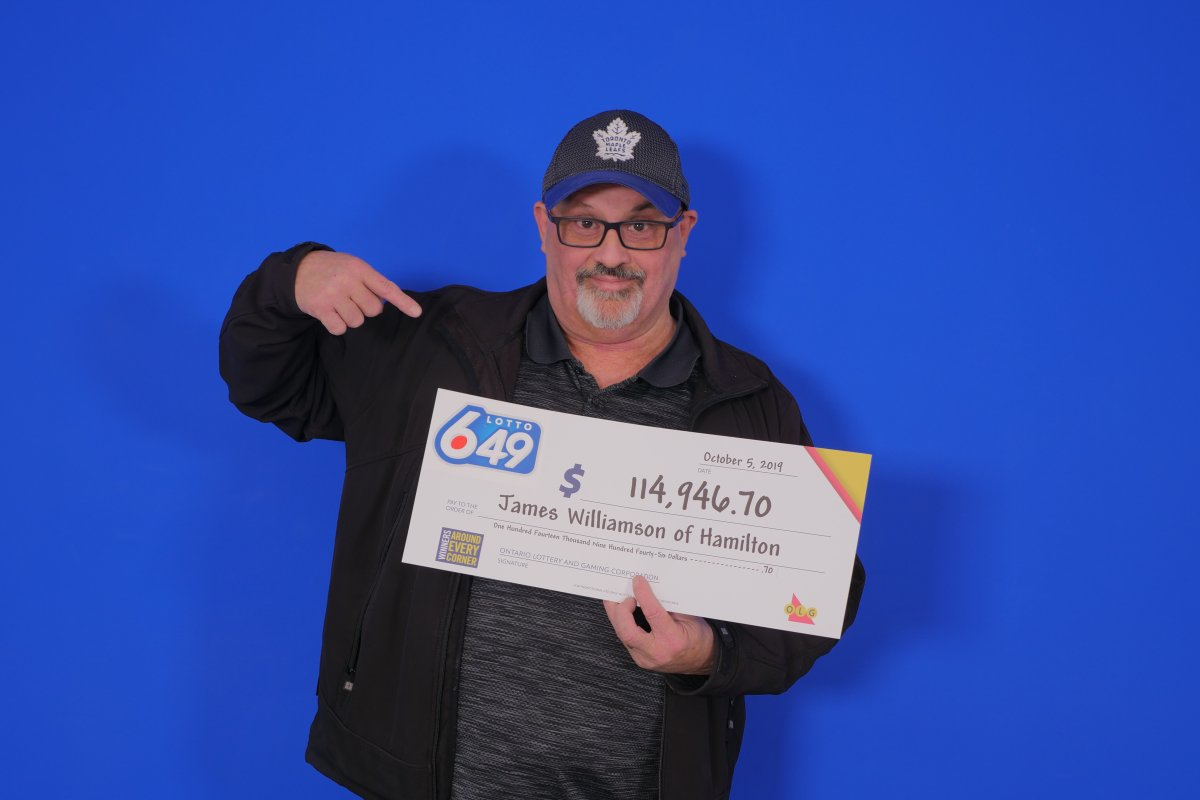 A smiling James Williamson of Hamilton holding a presentation cheque for 114,946.70 after winning a Sept. Lotto 6/49 draw.