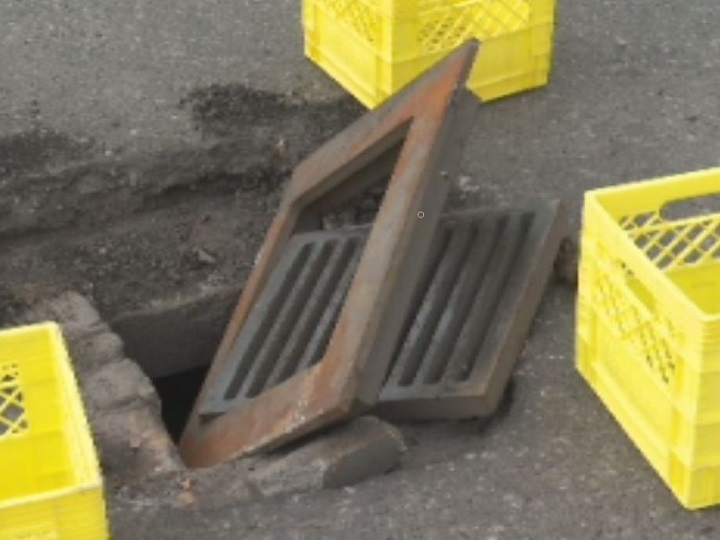 Lorinda and Lorne Pearson of Grand Forks say this loose grate at a McDonald's parking lot in Kelowna damaged their truck.