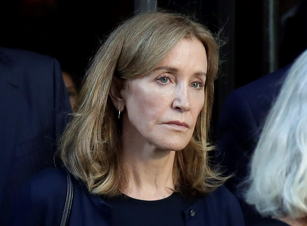 Actress Felicity Huffman leaving federal court after her sentencing in a nationwide college admissions bribery scandal in Boston.
