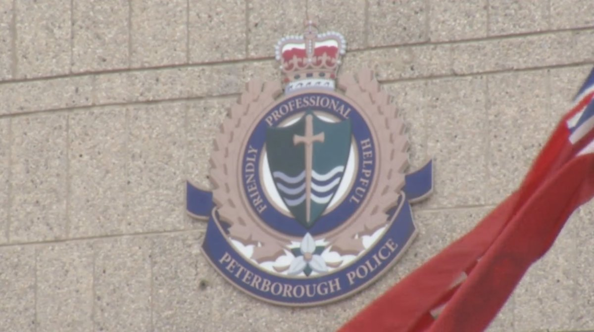 A Peterborough woman is accused of assaulting two emergency service workers.