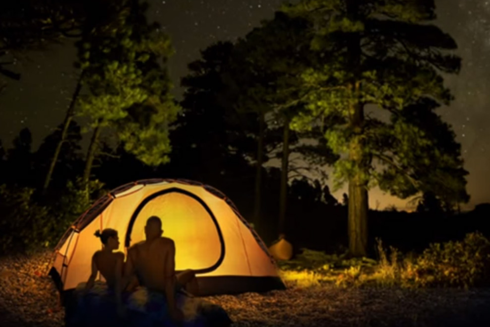 Two campers are shown in this promotional image for Rock Haven Lodge Family Nudist Park in Murfreesboro, Ten.
