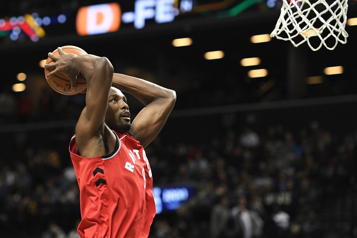 Toronto Raptors forward Serge Ibaka (9) attempts a basket during the second quarter of a preseason NBA basketball game against the Brooklyn Nets, Friday, Oct. 18, 2019, in New York.