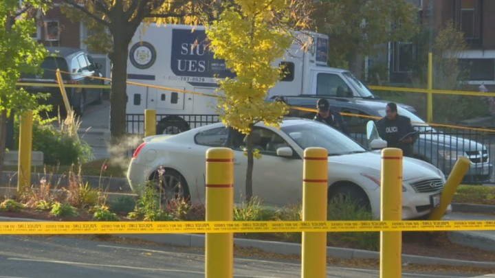 Investigators at the scene of the police-involved shooting in North York Saturday.