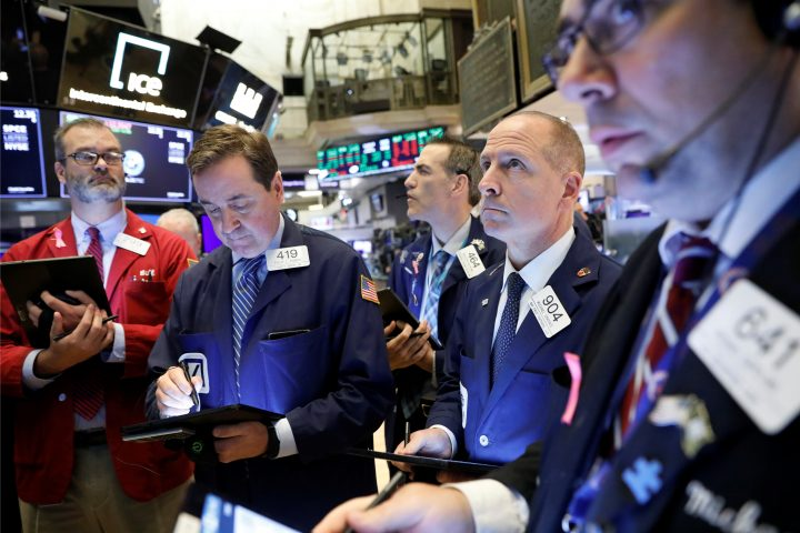 Traders work on the floor at the New York Stock Exchange (NYSE) in New York, U.S., October 28, 2019.