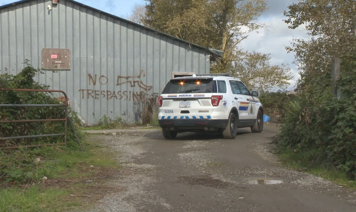 RCMP outside a property in Surrey, which was raided on Oct. 5, 2019 over allegations of a possible cockfighting operation.