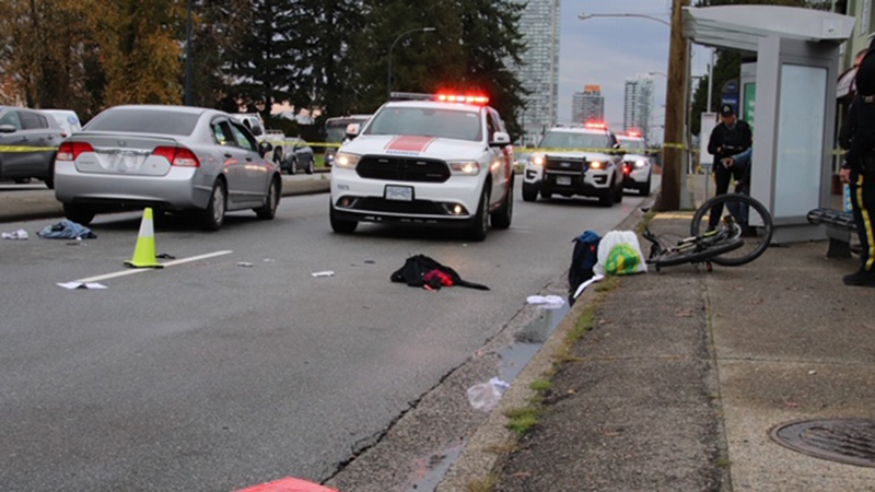 Police and paramedics at the scene of a collision involving a vehicle and a cyclist who was critically injured on Oct. 18, 2019.