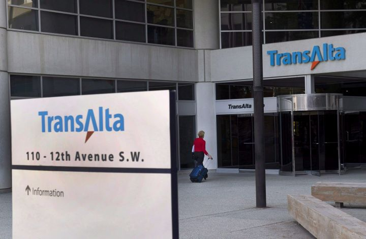 A woman walks towards the entrance of the TransAlta headquarters building in Calgary, on Tuesday, April 29, 2014.