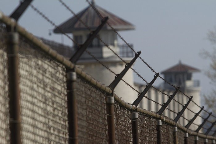 The fence outside the Kingston Penitentiary in Kingston, Ont., on Thursday April 19, 2012.