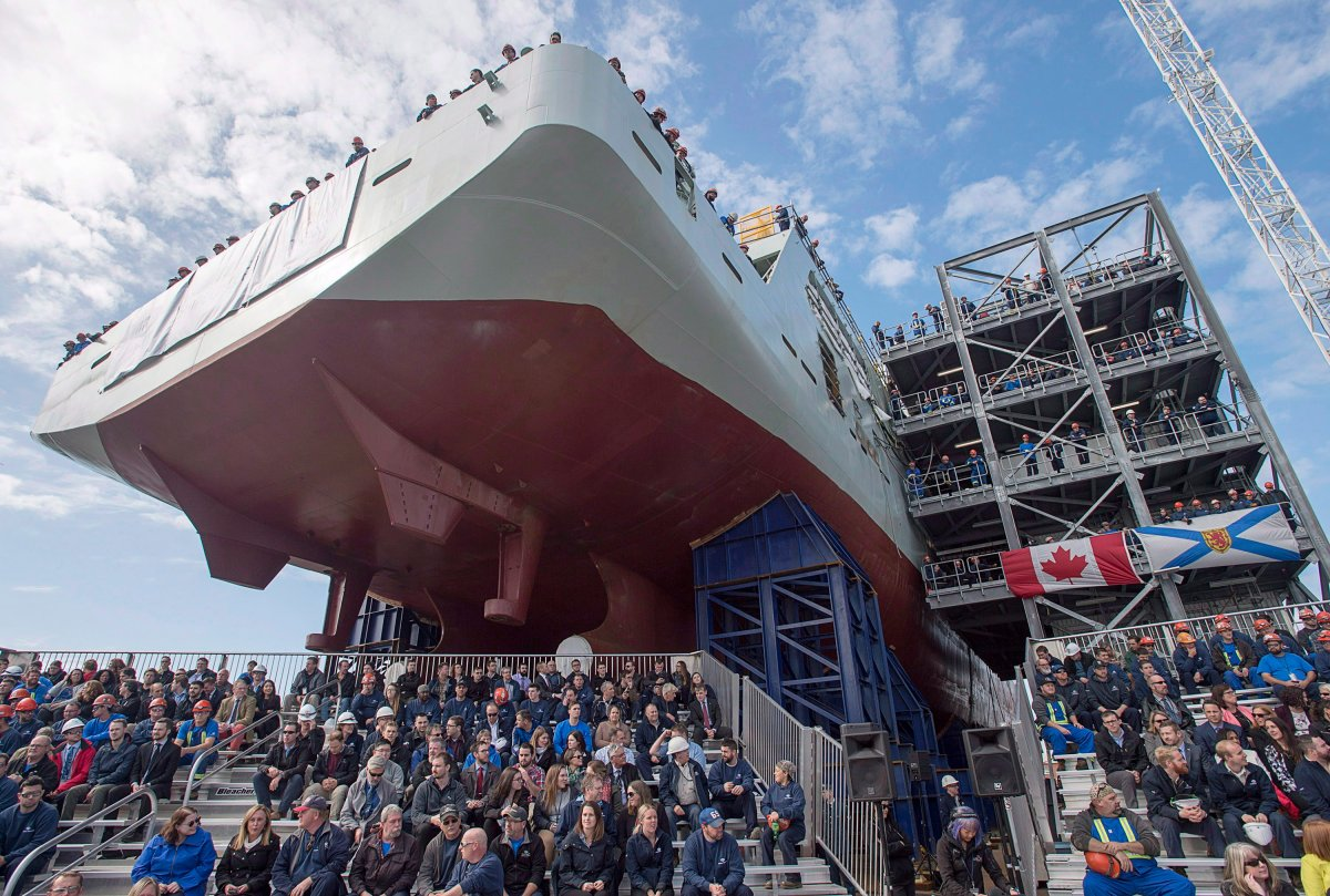 Shipyard workers attend the naming ceremony for Canada's lead Arctic and Offshore Patrol Ship, the future HMCS Harry DeWolf, in Halifax on Friday, Oct. 5, 2018.
