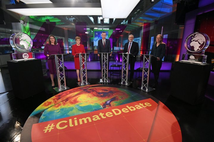 Liberal Democrat leader Jo Swinson, SNP leader Nicola Sturgeon, Plaid Cymru leader Adam Price, Labour Party leader Jeremy Corbyn and Green Party Co-Leader Sian Berry, stand next to ice sculptures representing the Brexit Party and Conservative Party who didn't appear at the event, before the start of the Channel 4 News' General Election climate debate at ITN Studios in Holborn, central London, Nov. 28, 2019.