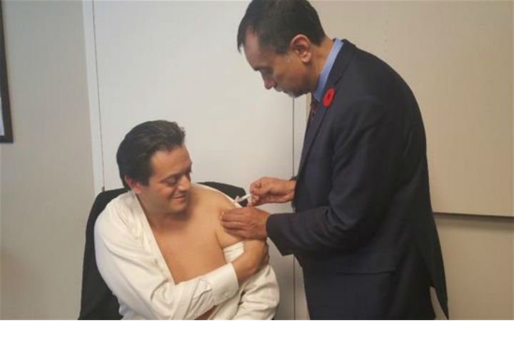 Barrie Mayor Jeff Lehman, left, receives his flu shot from Ontario Medical Association president Dr. Sohail Gandhi. The two met briefly on Monday to get acquainted and discuss the importance of immunization in the community.