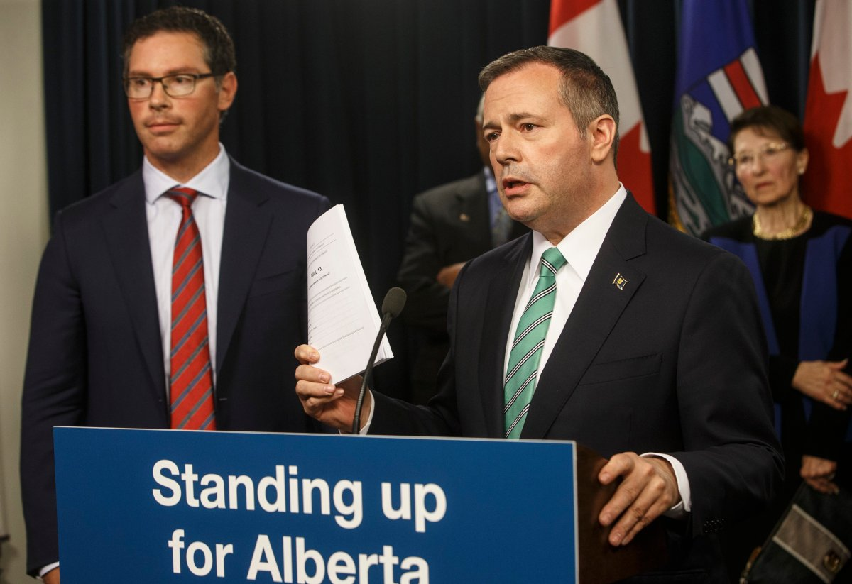 Alberta premier Jason Kenney, right and Doug Schweitzer, Minister of Justice and Solicitor General, in Edmonton Alta, on Wednesday June 26, 2019.