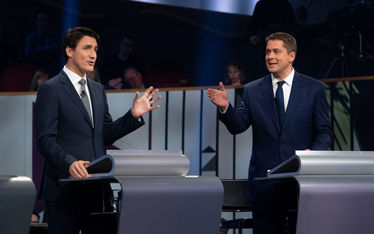 Liberal leader Justin Trudeau and Conservative leader Andrew Scheer take part in the the Federal leaders French language debate in Gatineau, Que. on Thursday, October 10, 2019.