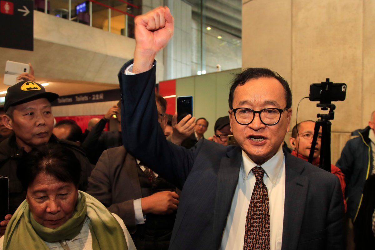Cambodia's most prominent opposition politician Sam Rainsy clenches his fist as he is attempting to return to Cambodia Thursday, Nov. 7, 2019 at Charles de Gaulle airport, north of Paris.