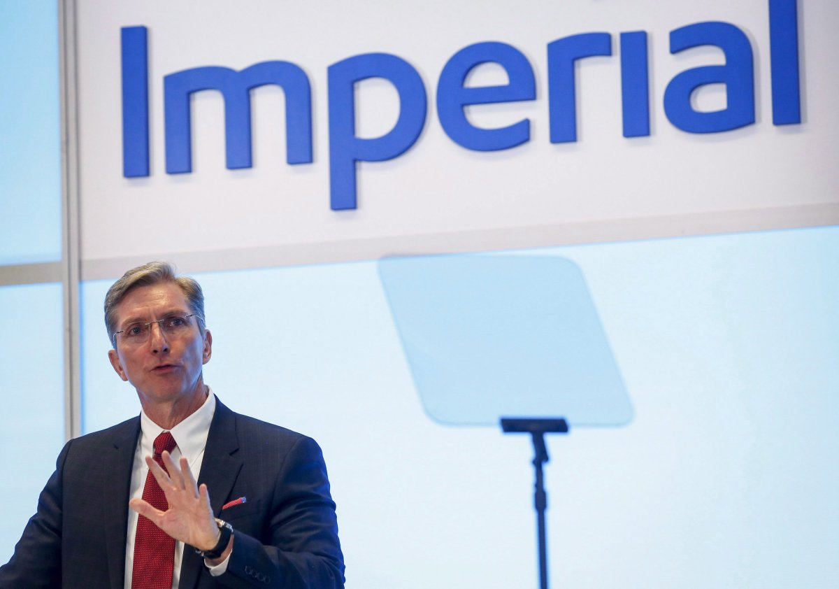 Rich Kruger, president and CEO of Imperial Oil, addresses the company's annual meeting in Calgary, Friday, April 29, 2016. The outgoing CEO of Imperial Oil Ltd. says the $2.6-billion Aspen oilsands project in northern Alberta it announced a year ago — only to cancel it a few months later — will remain on the sidelines until the province completely ends its oil curtailment plan.