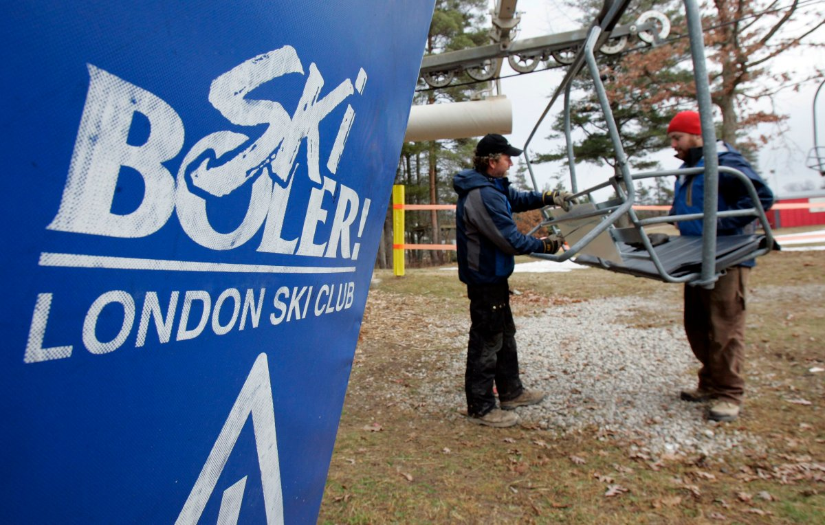 Signs are added to the chair lift on Boler Mountain in London, Ontario, Friday, Dec. 29, 2006.