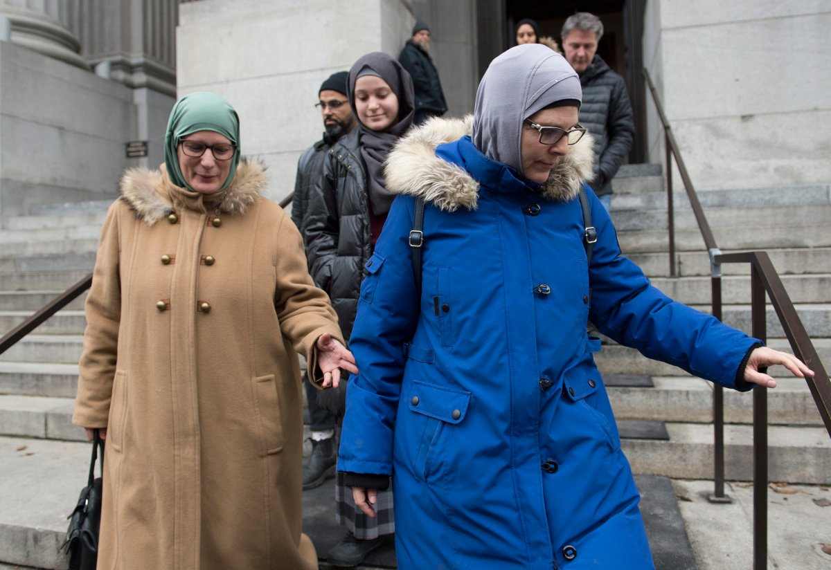 Women wearing hijabs leave the Quebec Court of Appeal in Montreal, Tuesday, Nov. 26, 2019, where members of the National Council of Muslims and the Canadian Civil Liberties Association (CCLA) challenged Quebec's Bill 21.