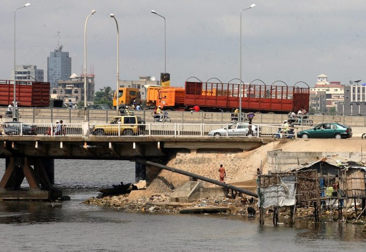 Motorists drive across a bridge towards the business district in Cotonou, Benin Republic, Friday Nov. 23 2007. A vessel owned by Norwegian shipping firm J.J. Ugland was boarded by pirates while at anchor off the coast of Benin on Saturday, and nine crew members were kidnapped.