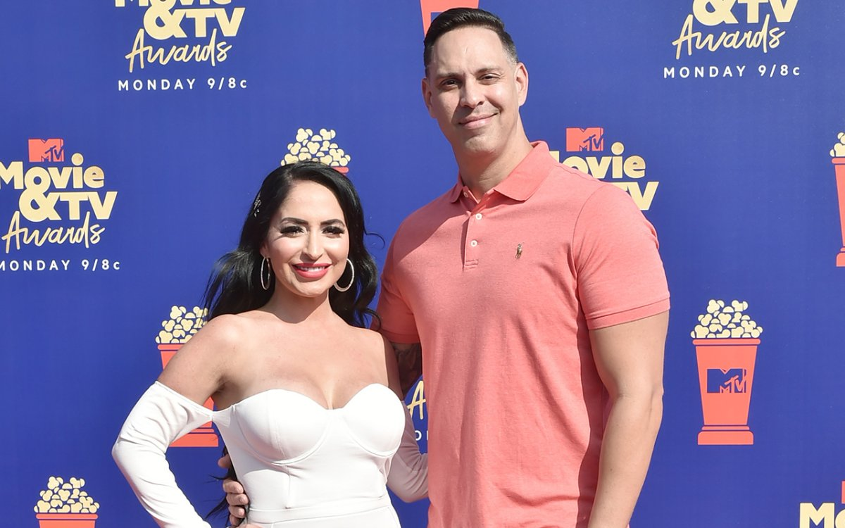 Angelina Pivarnick and Chris Larangeira attend the 2019 MTV Movie & TV Awards - Arrivals at Barker Hangar on June 15, 2019 in Santa Monica, California.