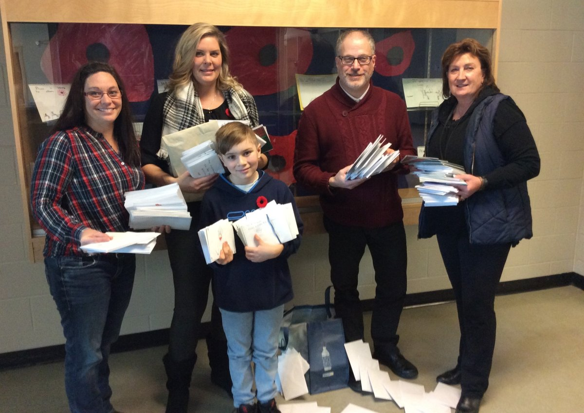 (From left) Joan Laythorpe, Donna Roth, Jordan Roth, Bruce Winston and Jean Hugill hold some of the more than 700 cards that will be sent to Canadian soldiers overseas this winter.