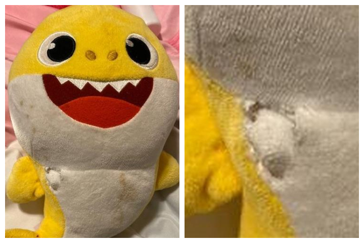 A Baby Shark toy is shown with a bullet hole in it after a shooting in Madison, Wis., on Nov. 24, 2019.